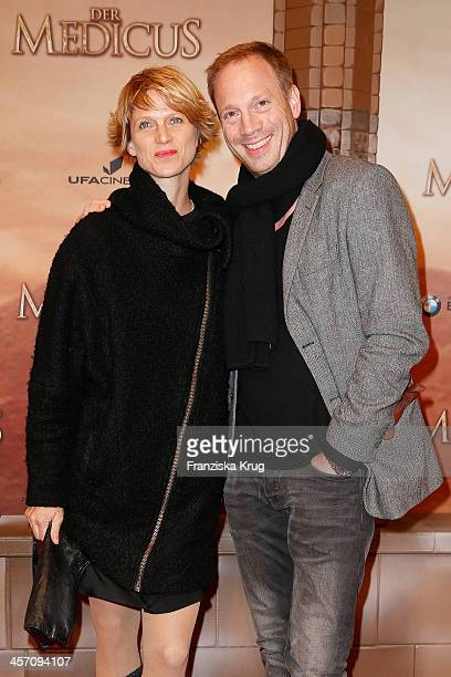 Katrin von Buelow and Johann von Buelow attend 'The Physician' German Premiere on December 16, 2013 in Berlin, Germany.