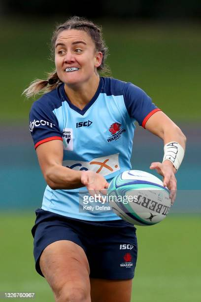 Katrina Barker of the Waratahs passes during the Super W Final match between the NSW Waratahs and the Queensland Reds at Coffs Harbour International...