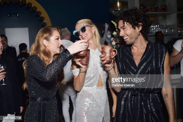 Katrina Barton Paris Hilton and Joey Maalouf attend Paris Hilton The Glam App Partnership Event on June 19 2019 in Hollywood California