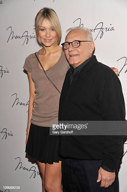 Katrina Bowden and designer Max Azria pose for pictures backstage at the Max Azria Fall 2011 fashion show during MercedesBenz Fashion Week at The...