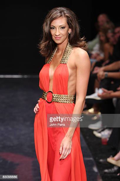 Katrina Campins walks the runway at the Red Dress Show for the American Heart Association during Funkshion Fashion Week at Miami Beach Botanical...