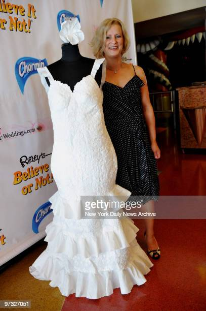 Katrina Chalifoux of Chicago poses with her winning creation during a toilet paper wedding dress construction contest at Ripley's Believe it or Not...