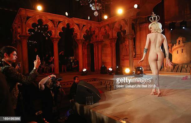 Katrina Darling who is a distant cousin of Kate Middleton and a burlesque dancer performs a striptease at the after show party at the 2013 Life Ball...