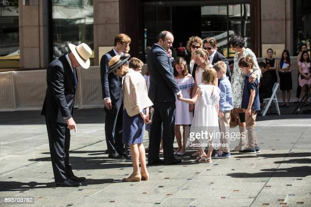 Katrina Dawsons family looks at the permanent memorial honouring the lives of Tori Johnson and Katrina Dawson at Martin Place on December 16 2017 in...