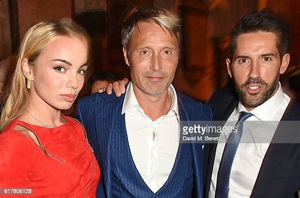 Katrina Durden, Mads Mikkelsen and Scott Adkins attend Marvel Studios and British GQ hosted reception in The Cloisters at Westminster Abbey, to...