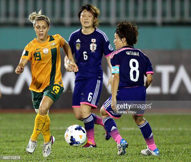 Katrina Gorry of Australia battles with Aya Miyama of Japan during the AFC Women's Asian Cup Final match between Japan and Australia at Thong Nhat...