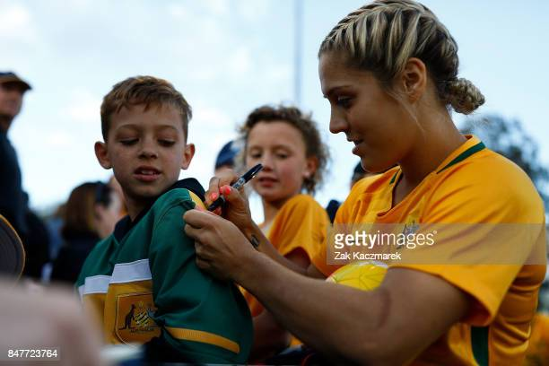 Katrina Gorry of Australia signs autographs and greets fans after the women's international match between the Australian Matildas and Brazil at...