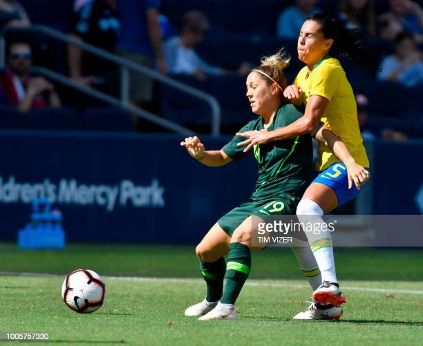Katrina Gorry of Australia vies for the ball with Thaisa of Brazil during their Tournament of Nations football match at Children's Mercy Park in...