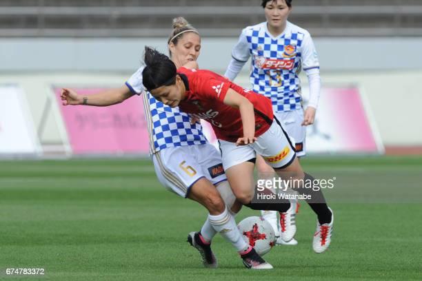 Katrina Gorry of Mynavi Vegalta Sendai Ladies and Hikaru Naomoto of Urawa Red Diamonds Ladies compete for the ball during the Nadeshiko League match...