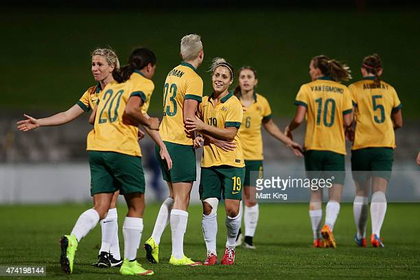 Katrina Gorry of the Matildas celebrates with team mates after scoring a goal during the international women's friendly match between the Australian...
