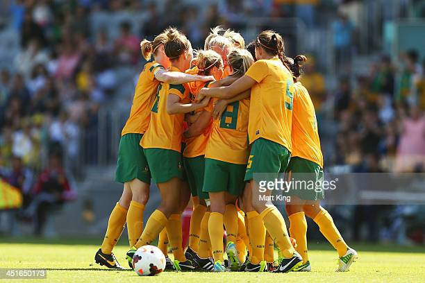 Katrina Gorry of the Matildas celebrates with team mates after scoring the first goal during the match between the Australian Matildas and China PR...