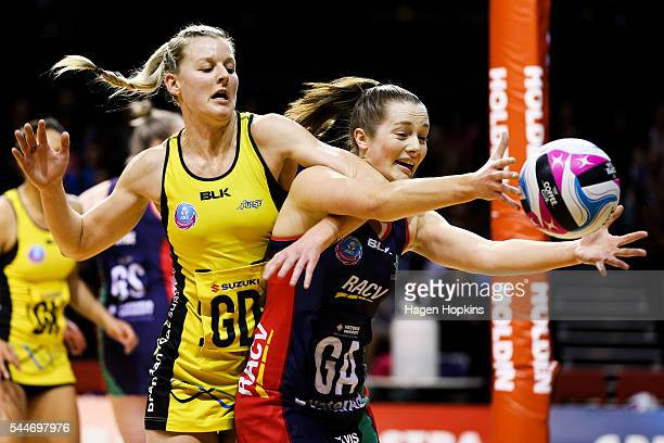 Katrina Grant of the Pulse and Alice TeagueNeeld of the Vixens compete for the ball during the ANZ Championship match between Central Pulse and...