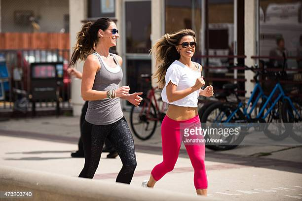 Katrina Hodgson and Karena Dawn arrive for the Tone It Up Beach Workout on May 13 2015 near the Hermosa Beach Pier in Hermosa Beach California