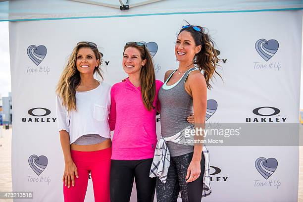 Katrina Hodgson and Karena Dawn pose and sign autographs for partipants after the Tone It Up Beach Workout on May 13 2015 near the Hermosa Beach Pier...
