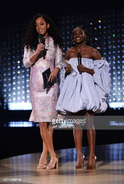Katrina Johnson Thompson and Dina Asher Smith present the Urban Luxe award during The Fashion Awards 2018 In Partnership With Swarovski at Royal...