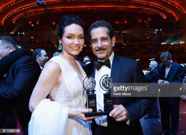 Katrina Lenk and Tony Shalhoub pose with their awards for The Band's Visit backstage during the 72nd Annual Tony Awards at Radio City Music Hall on...