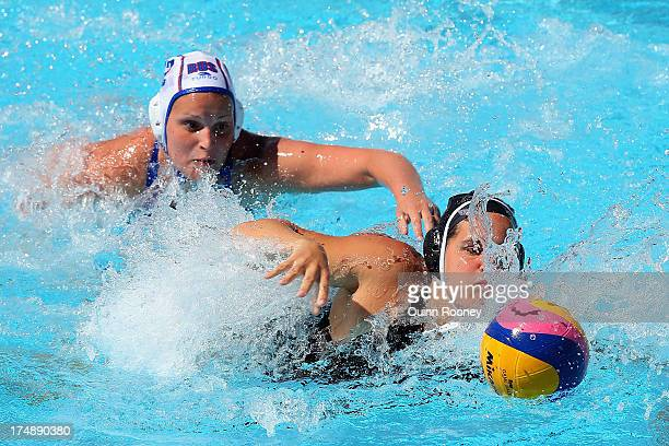 Katrina Monton of Canada and Ekaterina Zelentsova of Russia comete for the ball during the Women's Water Polo quarterfinal match between Russia and...