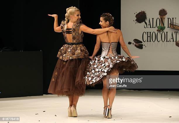Katrina Patchett and Denitsa Ikonomova walk the runway during the Chocolate Fashion Show as part of Salon du Chocolat Paris 2016 at Parc des...