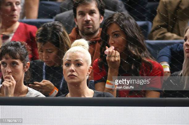 Katrina Patchett behind Jade Lagardere wife of Arnaud Lagardere cheers for Benoit Paire of France during his second round match against Gael Monfils...