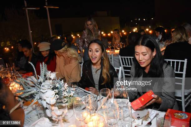 Katrina Razon and Bo Carney attend the Flaunt Magazine Dinner with Nike and Revolve on February 15 2018 in Los Angeles California