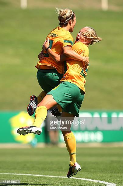 Katrina-Lee Gorry and Tamika Butt of Australia celebrate a goal by Gorry during the match between the Australian Matildas and China PR at WIN Stadium...