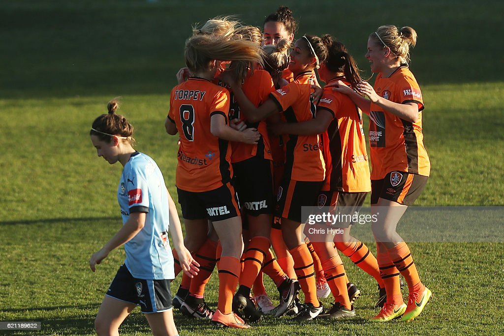 Katrina-Lee Gorry of the Roar celebrates a goal with team mates during the round one W-League match between the Brisbane Roar and Sydney FC at Spencer Park on November 5, 2016 in Brisbane, Australia.