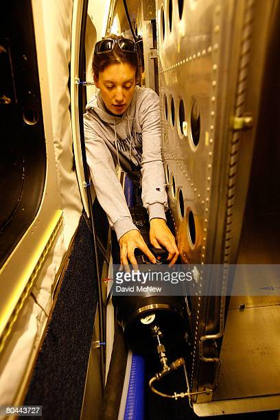 Katrine Gorham, of University of California Irvine, makes final preparations of equipment for taking whole air samples of the atmosphere aboard a...