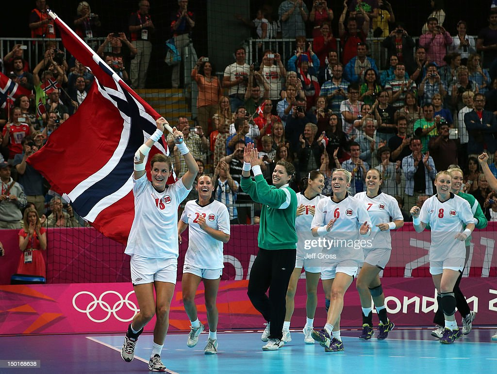 Katrine Lunde Haraldsen #16 of Norway celebrates with her teammates after winning the gold medal against Montenegro in the Women's Handball Final Match on Day 15 of the London 2012 Olympics Games at Basketball Arena on August 11, 2012 in London, England.