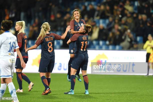 Katrine Veje and players of Montpellier celebrates scoring during the UEFA women's Champions League match Round of 16 second leg between Montpellier...