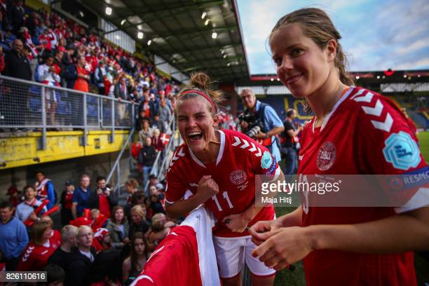 Katrine Veje of Denmark and Sofie Junge Pedersen celebrate after the UEFA Women's Euro 2017 Semi Final match between Denmark and Austria at Rat...