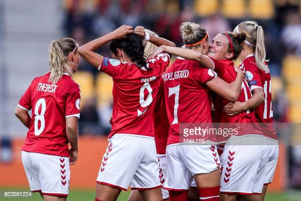 Katrine Veje of Denmark celebrate with her team mates after she scores the opening goal during the Group A match between Norway and Denmark during...