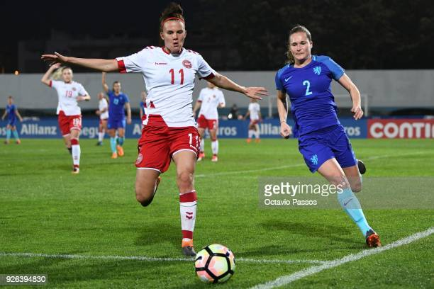 Katrine Veje of Denmark competes for the ball with Desiree Van Lunteren of Holland during the Women's Algarve Cup Tournament match between Denmark...
