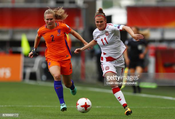 Katrine Veje of Denmark holds off pressure from Desiree van Lunteren of the Netherlands during the Final of the UEFA Women's Euro 2017 between...
