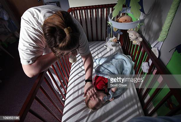 Katrisa Parks puts her eightmonthold son Skyler down for a nap in the room they share at the Decatur Correctional Center February 18 2011 in Decatur...