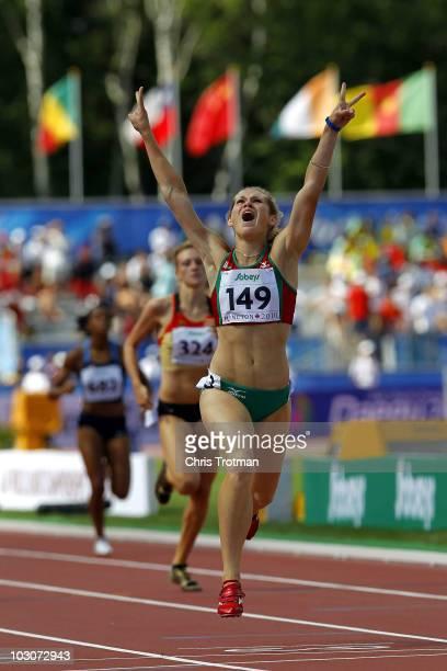 Katsiaryna Artsiukh of Belarus celebrates finishing first in the Women's 400 Metre Hurdles Final on day six of the 13th IAAF World Junior...