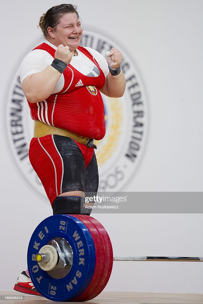 Katsiaryna Shkuratava from Belarus celebrates her lift in the Clean & Jerk competition women's +75 kg Group A during weightlifting IWF World Championships Wroclaw 2013 at Centennial Hall on October 26, 2013 in Wroclaw, Poland