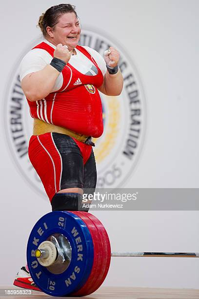 Katsiaryna Shkuratava from Belarus celebrates her lift in the Clean Jerk competition women's 75 kg Group A during weightlifting IWF World...