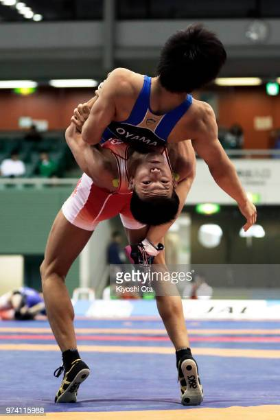 Katsuaki Endo competes against Mitsunaga Oyama in the Men's GrecoRoman style 63kg second round match on day one of the All Japan Wrestling...
