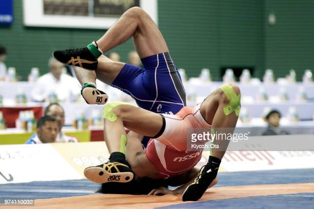 Katsuaki Endo competes against Ryo Matsui in the Men's GrecoRoman style 63kg final on day one of the All Japan Wrestling Invitational Championships...
