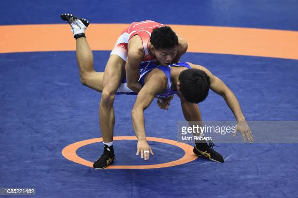 Katsuaki Endo competes against Yoshiki Yamada during the men's 63kg men's GrecoRoman Final on day two of the Emperor's Cup All Japan Wrestling...