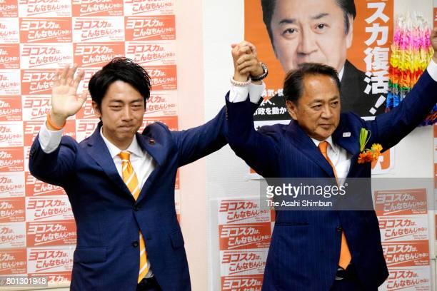 Katsuaki Kamiji celebrates winning the Yokosuka mayoral election with lower house lawmaker Shinjiro Koizumi at his election campaign headquarters on...
