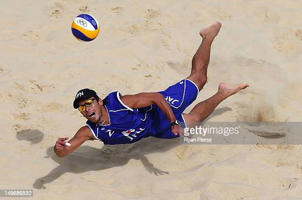 Katsuhiro Shiratori of Japan dives for a shot during the Men's Beach Volleyball preliminary match between Japan and Spain on Day 6 of the London 2012...