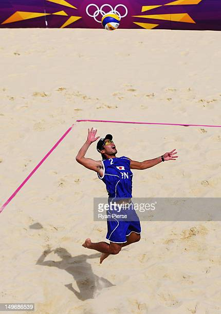 Katsuhiro Shiratori of Japan serves during the Men's Beach Volleyball preliminary match between Japan and Spain on Day 6 of the London 2012 Olympic...