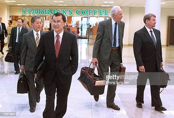 Katsunari Suzuki Japanese Ambassador Charles Kartman Secetary of the Korean Peninsula Energy Development Organization JeanPierre Leng European Union...