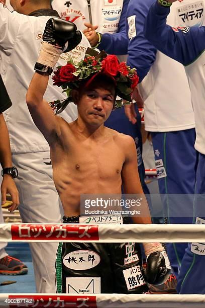 Katsunari Takayama of Japan celebrates over the victory Ryuji Hara of Japan during the IBF world minimumweight title bout between Katsunari Takayama...