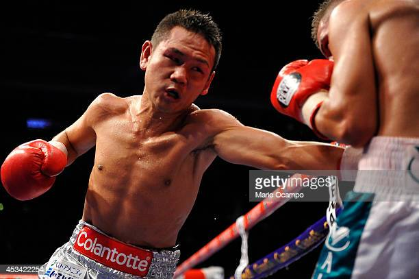 Katsunari Takayama punches Francisco Rodriguez 'El Chihuas' on the stomach during the IBF/WBO Minimumweight Unification Title fight between Francisco...