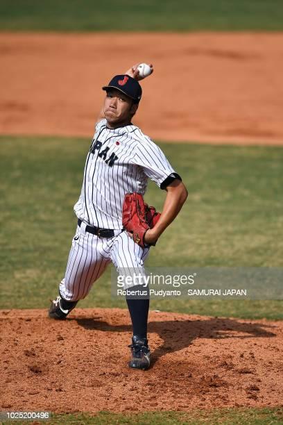 Katsuno Akiyoshi of Japan pitches in the ninth inning of the Men's Team Baseball Super Round game between Korea and Japan at GBK Baseball Stadium on...
