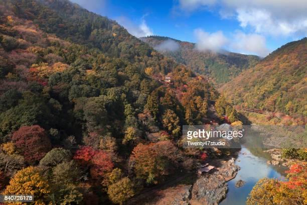 Katsura River and village closed to river, Arashiyama in beautiful autumn season, Kyoto, Japan.