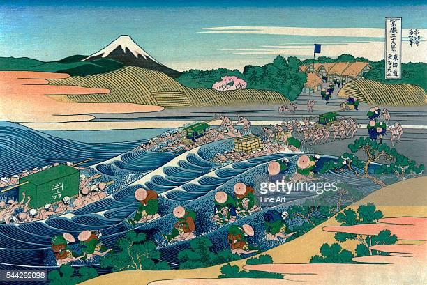 Katsushika Hokusai 17601849Tokaido kanaya no fuji Color woodcut Print shows porters carrying litters sedan chairs and individual persons across the...