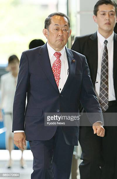 Katsutoshi Kaneda newly appointed as justice minister in a Cabinet reshuffle enters the prime minister's office in Tokyo on Aug 3 prior to the...